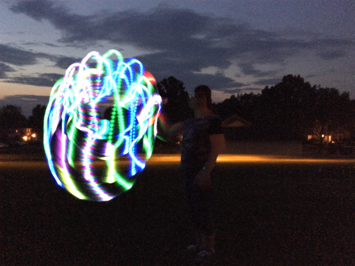 Palm spin hooping with LED Light trails