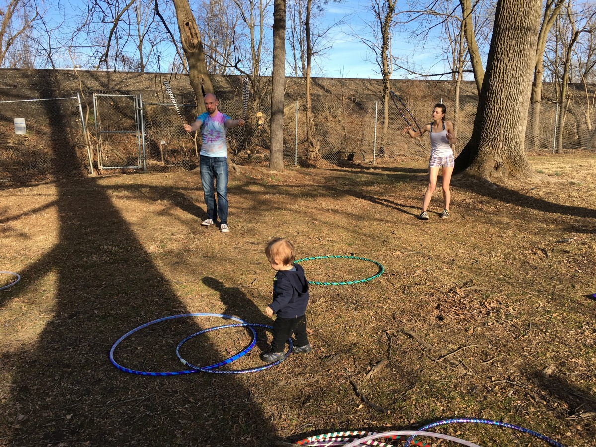 Marcus with poi, Bethani hooping, and Thorin trying to make a go of it.