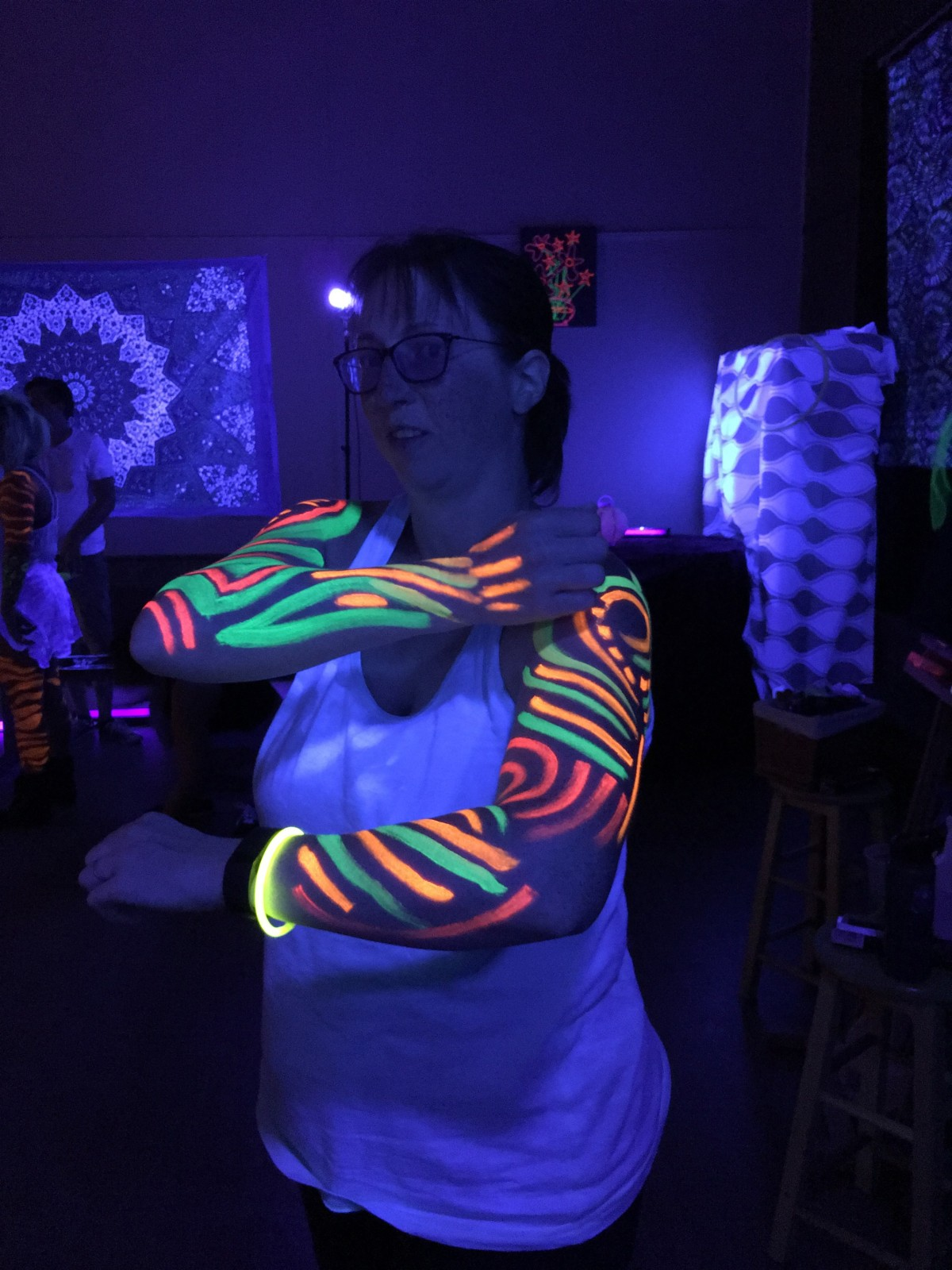 Me under a black light with body painting